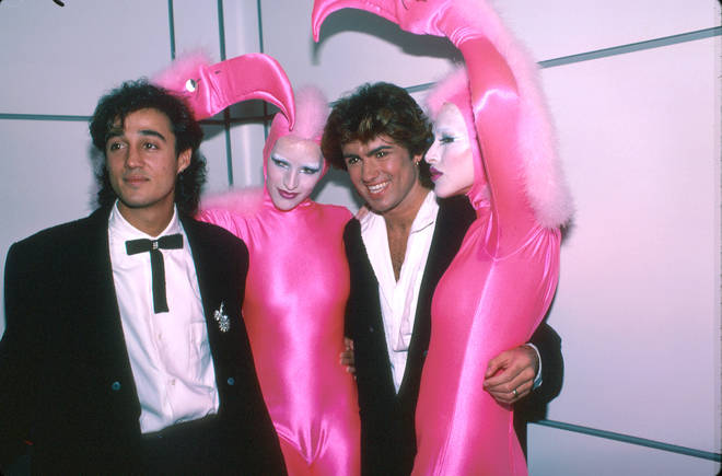 Andrew Ridgeley and George Michael of pop group Wham! with pink flamingo dancers