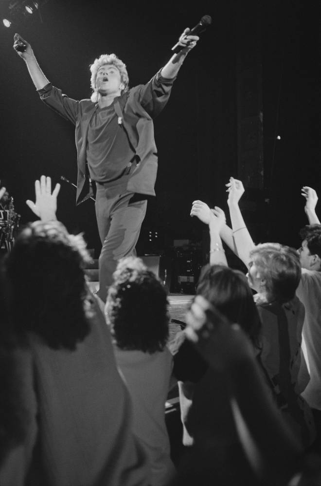 George Michael performs live on stage with pop duo Wham! in front of fans during their 1985 world tour in January 1985.