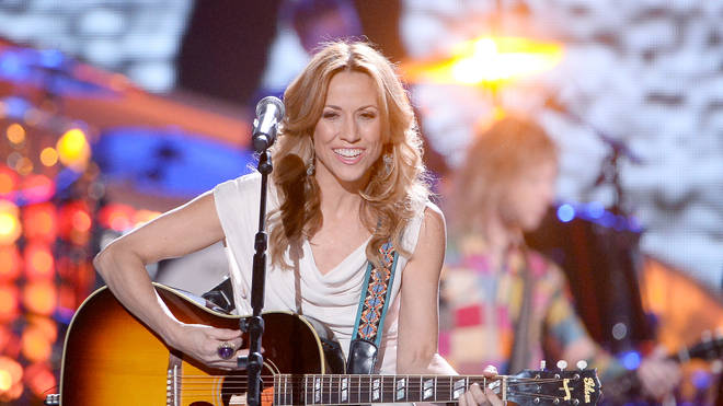 Sheryl Crow performing at the 2013 American Country Awards