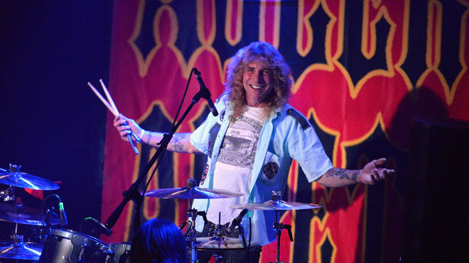 Steven Adler performing in 2018