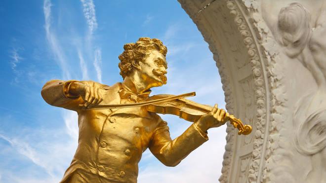 The golden statue of Johann Strauss, by Edmund Hellmer, in Stadpark in Vienna.