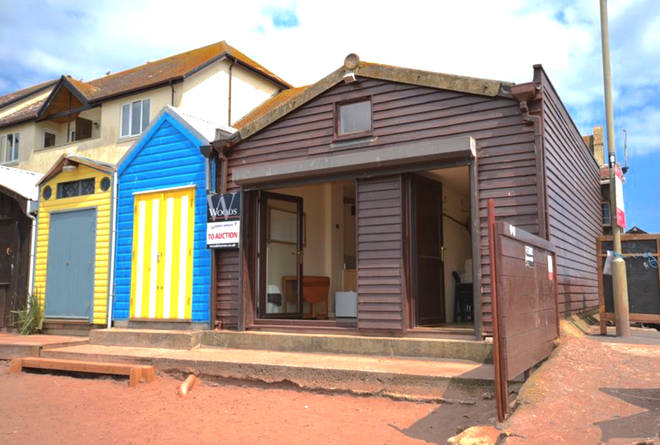 The Teignmouth property is on the plot of to beach huts