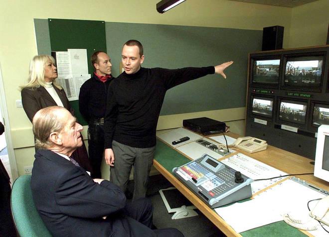 Adam Woodyatt showing Prince Philip around the set of EastEnders
