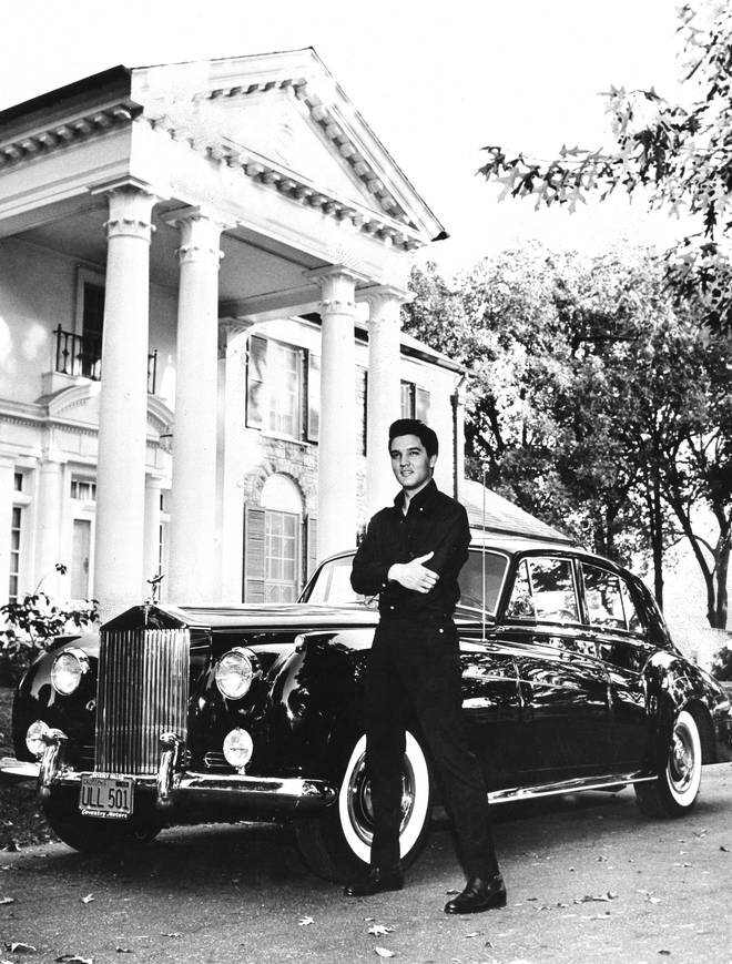 Elvis Presley outside his Graceland home