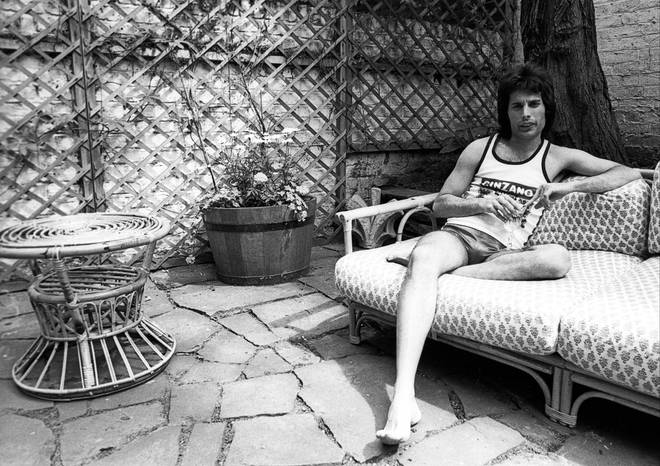 Freddie Mercury posing for a portrait in 1975 at his home in Holland Park, London