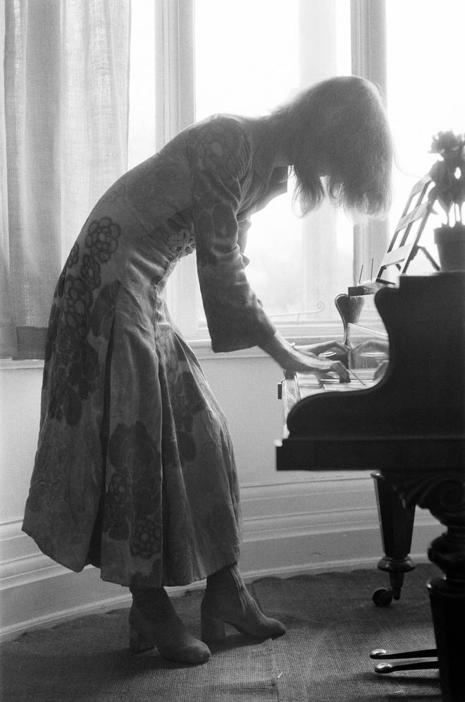 David Bowie plays the piano at Haddon Hall, Kent in 1971