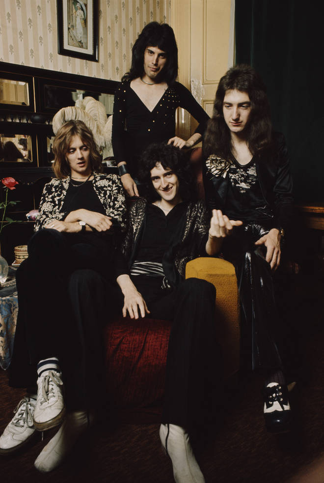 Queen posed in lead singer Freddie Mercury's flat, Holland Road, West Kensington, London in early 1974. Left to right: Roger Taylor, Freddie Mercury (1946-1991), Brian May (bottom) and John Deacon.