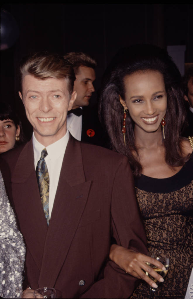 David Bowie and Iman pictured at their first public appearance together just months after meeting in 1990, attending the Seventh on Sale AIDS Benefit on November 29 at the Armory in New York City