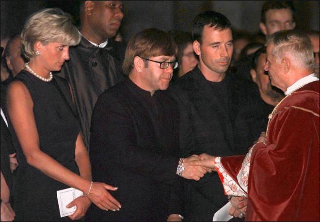 Princess Diana standing next to Elton John during the requiem mass for Italian fashion designer Gianni Versace