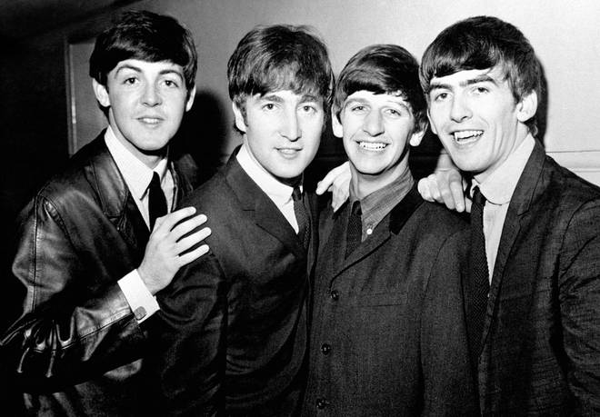 The Beatles photographed in 1965 around the time they met Elvis Presley