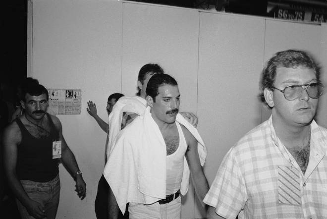 Freddie Mercury and his longterm boyfriend Jim Hutton (pictured left) backstage at the Live Aid concert at Wembley, 13th July 1985.