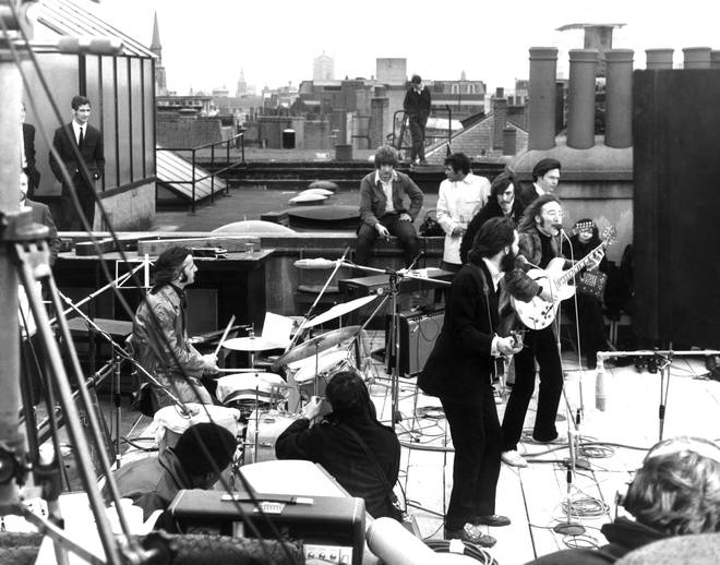 The Beatles performing their last live public concert on a rooftop in 1969