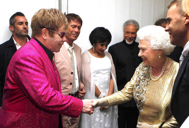 Sir Elton John meeting the Queen at her 2012 Diamond Jubilee concert