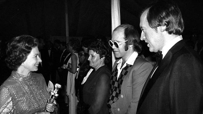 The Queen speaking to Sir Elton John at her Silver Jubilee