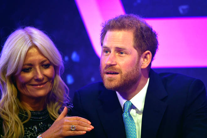 Gaby Roslin giving emotional Prince Harry a pat on the arm