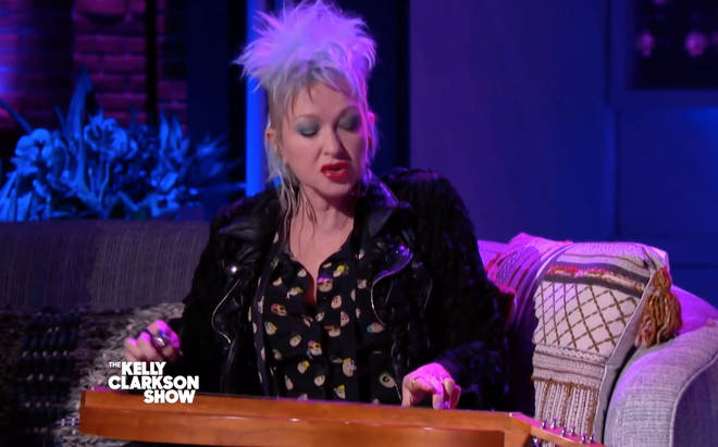 Cyndi Lauper playing her song on an Appalachian dulcimer