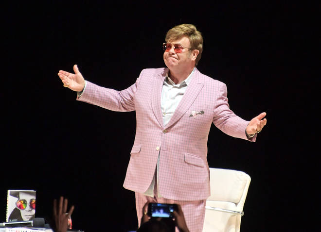 Sir Elton John speaking to the audience in Hammersmith